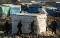 648x415_des_policiers_patrouillent_dans_le_camp_de_migrants_appele_la_jungle_a_calais_le_20_janvier_2016