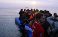 648x415_des_migrants_arrivent_le_20_mars_2016_sur_l_ile_de_lesbos