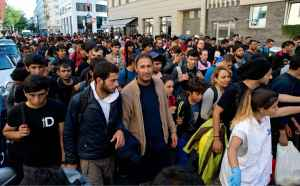 2048x1536-fit_migrants-arrives-gare-munich-allemagne-12-septembre-2015